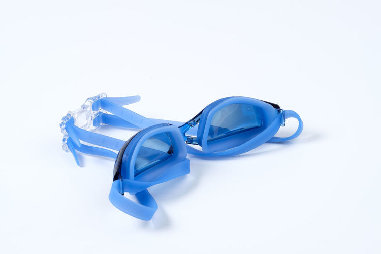 Blue Clean Equipment Glossy Goggle Goggles Rubber Swim Swimming Swimming Goggle White White Background Studio Shot Still Life Indoors  Copy Space Cut Out Close-up No People Single Object High Angle View Two Objects Plastic Three Objects Group Of Objects Shiny Healthcare And Medicine White Color Shape Design