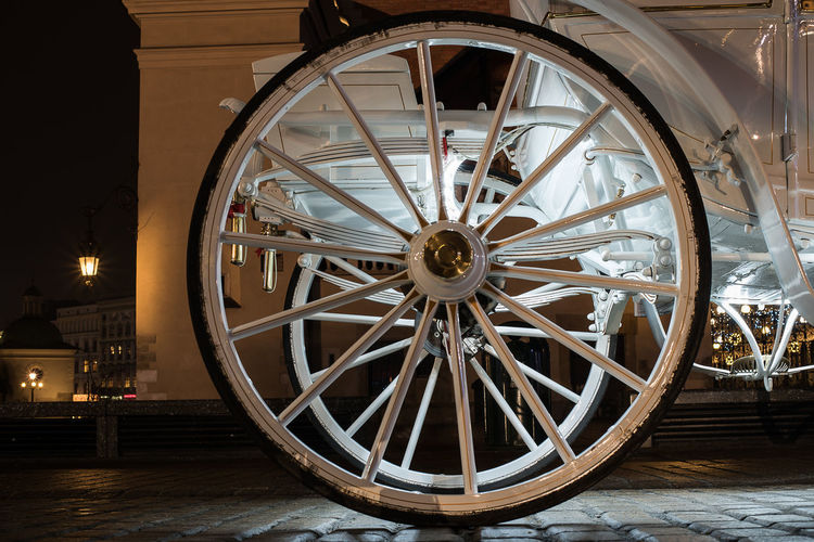 AN OLD WHEEL OF A CARRIAGE Canon Day History Illuminated No People Old-fashioned Outdoors Wagon Wheel Weapon Wheel Wood - Material