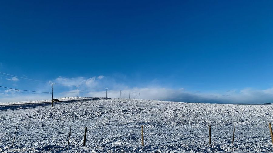 Sky Snow Winter Nature Cold Temperature Scenics - Nature Environment Blue Land Beauty In Nature Cloud - Sky Fuel And Power Generation Day Field No People Tranquil Scene Tranquility Covering Non-urban Scene Outdoors Electricity  Power Supply Winter Morning