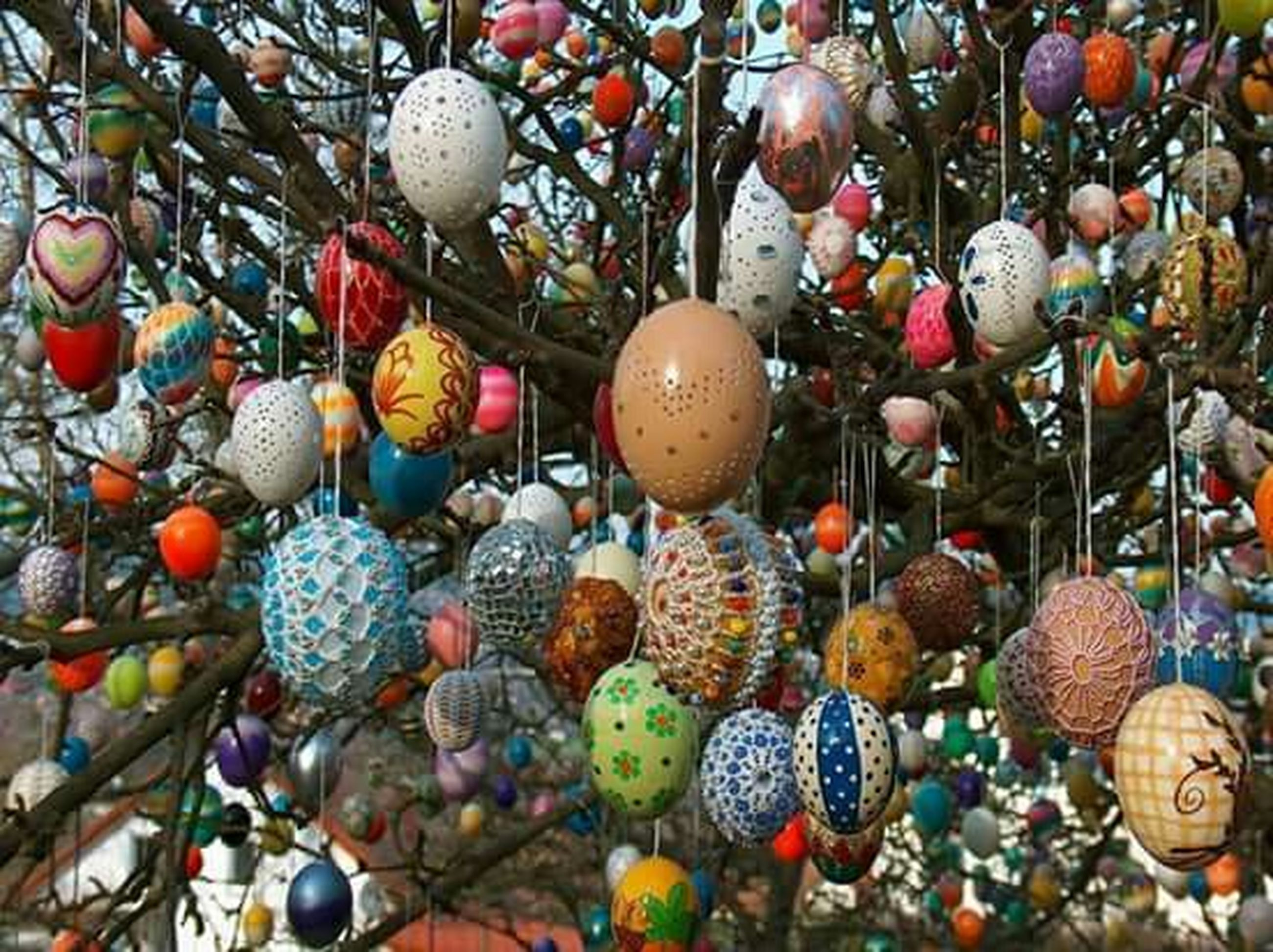 large group of objects, abundance, variation, hanging, multi colored, decoration, close-up, no people, still life, high angle view, celebration, choice, arrangement, day, outdoors, sphere, tradition, group of objects, christmas ornament, collection