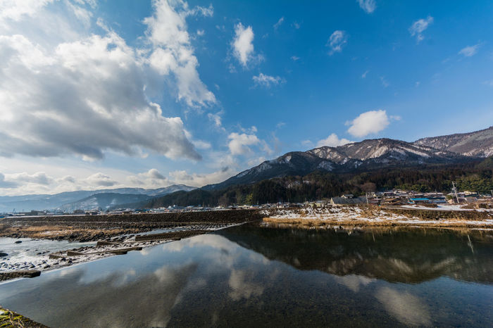 River and snow mountain EyeEmNewHere Japan Cloud - Sky Clouds And Sky Mountain Outdoors River Sky Snow Snow Mountain Water