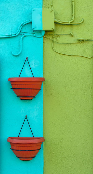 Turquoise and green double colored wall with two empty flower pots Wall - Building Feature No People Built Structure Architecture Blue Day Building Exterior Green Color Close-up Red Outdoors Turquoise Colored Connection Wall Group Of Objects Full Frame Backgrounds Burano Italy Venice Venezia Colorful Bright Symmetry Broken Symmetry Stucco Minimalism Space For Text Space For Copy Vertical Symmetry Traditional Tourist Destination Plastic Vases Flower Vases Empty Stucco Wall Stucco Texture