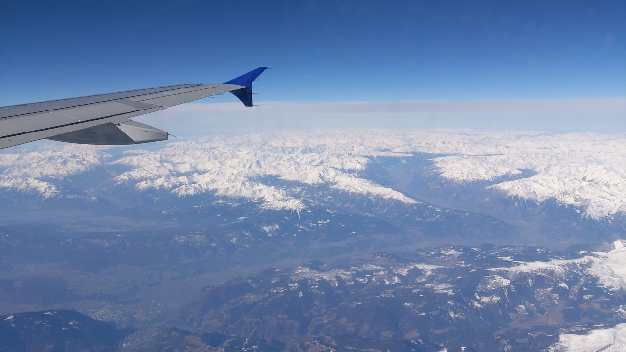 airplane, aerial view, journey, transportation, flying, airplane wing, nature, beauty in nature, scenics, aircraft wing, air vehicle, travel, sky, mode of transport, landscape, tranquil scene, no people, mid-air, mountain, snow, blue, cold temperature, day, outdoors, winter, tranquility, view into land