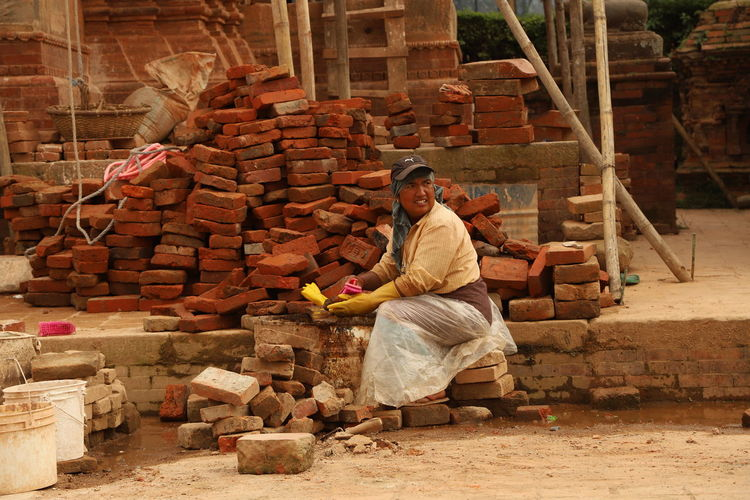 Nepal Adult Adults Only Architecture Brick Wall Building Exterior Day Full Length Manual Worker Men Metal Industry One Man Only One Person Only Men Outdoors People Real People Sitting Stack Working