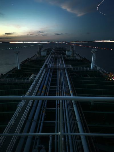 Low angle view of a vessel navigatinh against sky at night