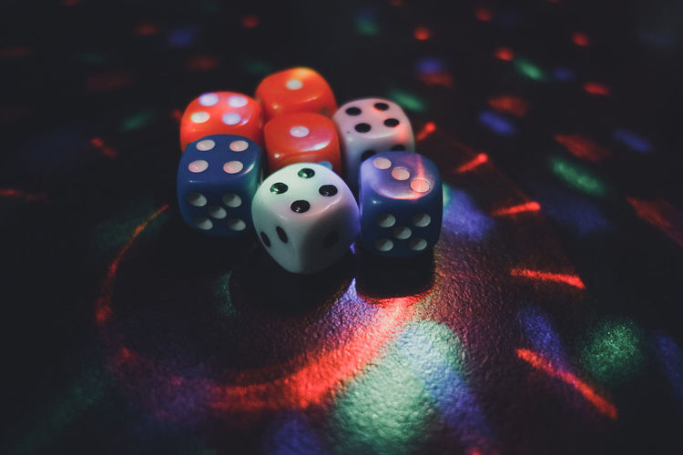 Colourful dice with lots of lighting effect gambling concept