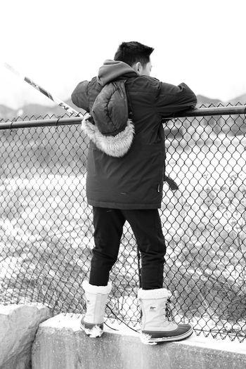 climbing to play hockey Adult Adults Only Casual Casual Clothing Climbing Day Fence Full Length Hockey Leisure Activity Men Only Men Outdoors People Real People Rear View Senior Adult Sport Standing Togetherness Warm Clothing Winter