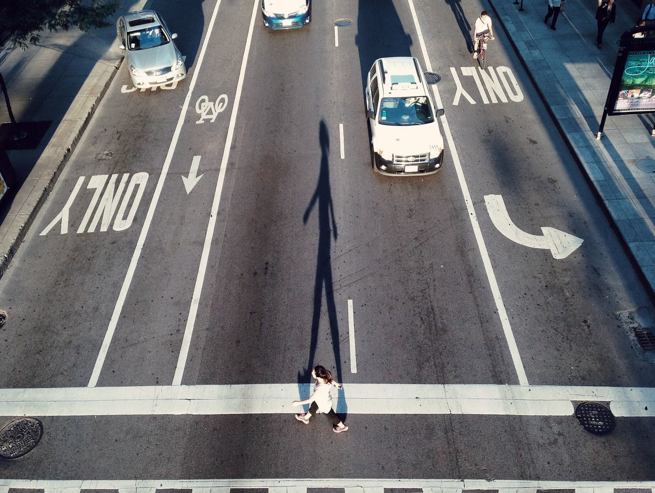 High angle view of woman crossing road