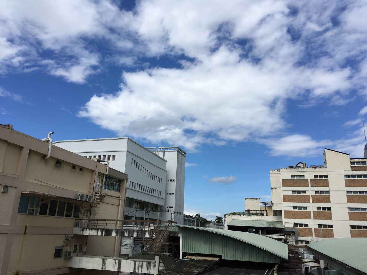 architecture, building exterior, built structure, cloud - sky, sky, low angle view, day, text, outdoors, no people, city