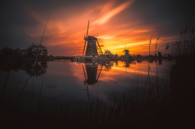 Holland Dutch House Windmills Photography Remo SCarfo Sky Sunset Water Reflection Cloud - Sky Fuel And Power Generation Beauty In Nature Orange Color Scenics - Nature Nature Tranquility Tranquil Scene Silhouette No People Plant Lake Tree Sun Environment Outdoors Kinderdijk Dutch EyeEm Best Shots EyeEmNewHere