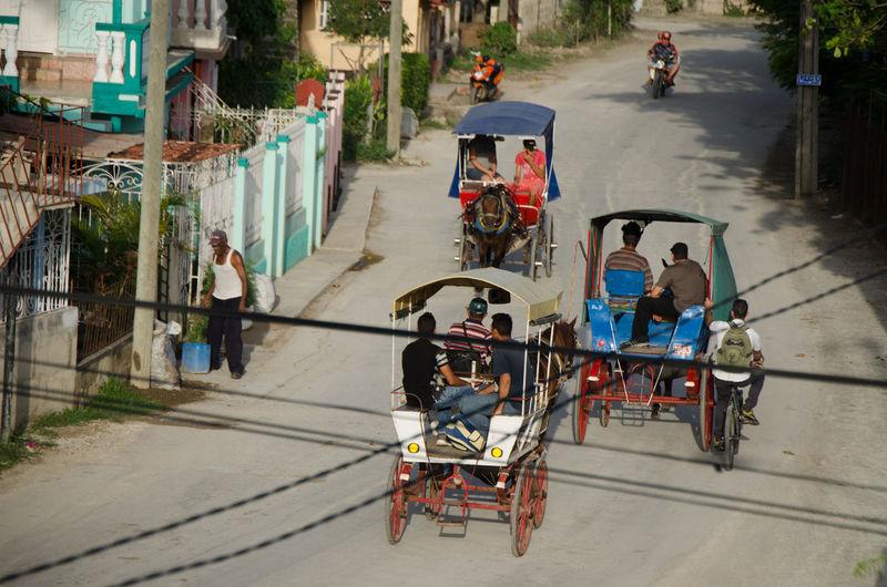 Cuban carriage Cuba Cuba Streets Carriage Land Vehicle Men Real People Street Transportation Wagons 마차