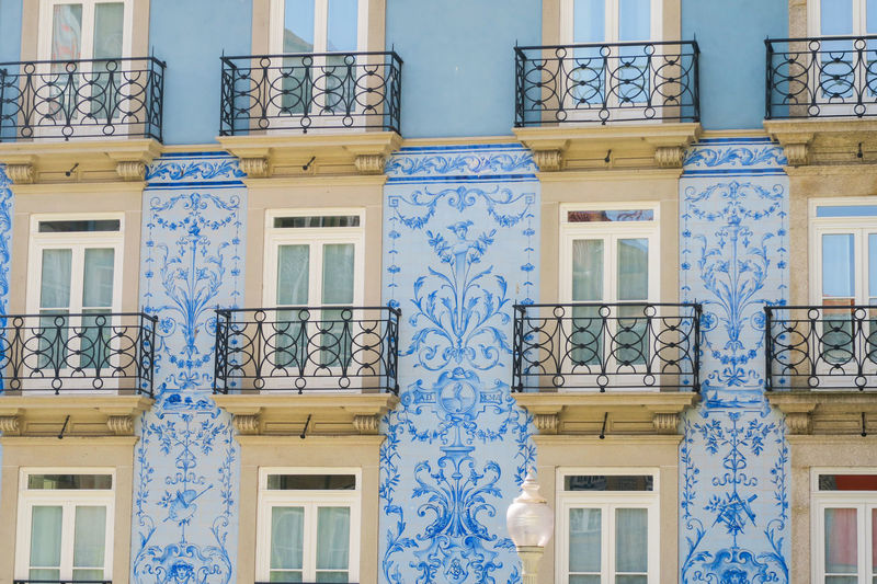 blue tiles on facade in porto old town, portugal Building Exterior Balcony Blue Sky Tile Mosaic Porto Portugal Window Frame On Old House Old Town Typical House Facades Painted Image Backgrounds Full Frame Window Pattern Architecture Building Exterior Close-up Built Structure