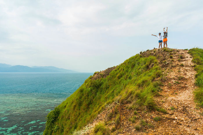 View from the Top Mountain Hill Summit Top Malalison, Antique Philippines Antique Sun Men Adventure Women Rural Scene Full Length Water Hiking Standing Sky Grass Lakeside Calm