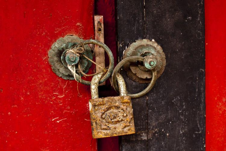 Close-up of lock on door knockers