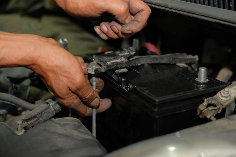 Close-up of mechanic repairing car