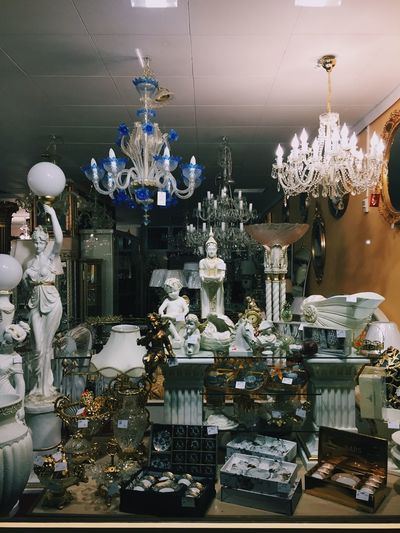 Illuminated chandelier hanging in room
