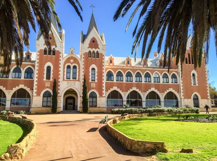 Spanish Gothic Architecture Old Landmark Historic Ornate Grandiose Spanish Style Australia Western Australia New Norcia Monastic Town Exterior Building Architecture Gothic Spanish Ladies College College St. Gertrude's Palm Trees Landscaped