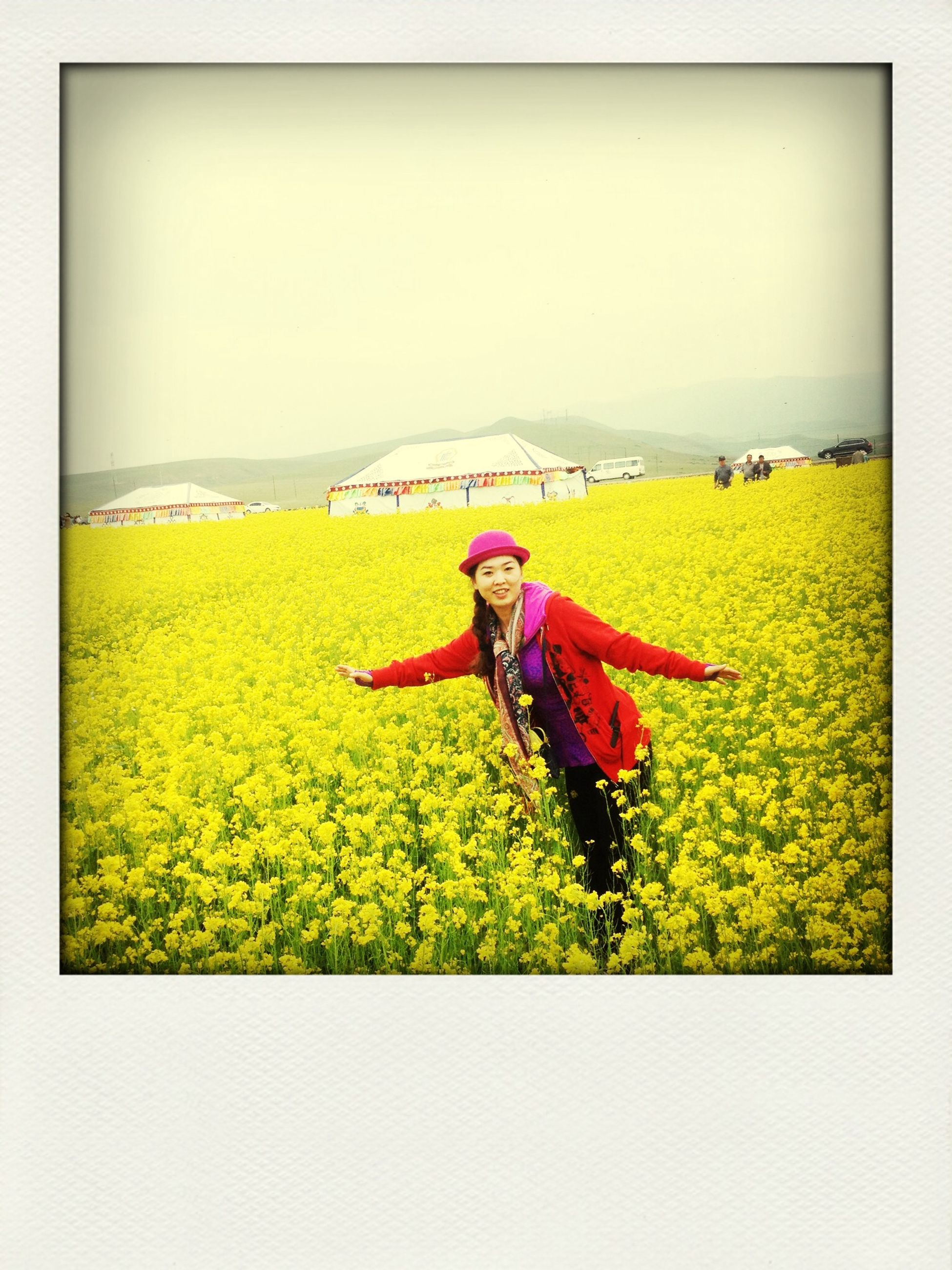 transfer print, auto post production filter, field, grass, childhood, lifestyles, leisure activity, yellow, green color, grassy, landscape, sport, sky, day, men, nature, casual clothing, full length