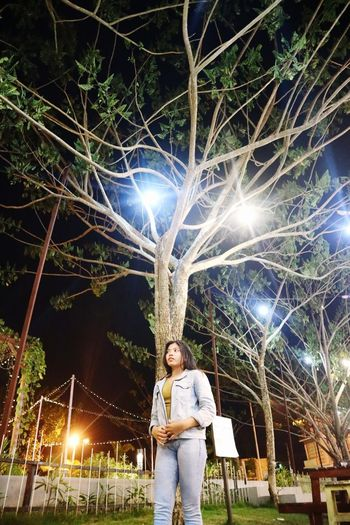 payung teduh Lendscape Lendscapephotography Moments Fun EyeEmNewHere Young Women Illuminated Women Standing Tree Light Beam Front View Mid Adult