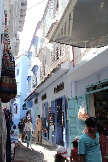Building Exterior Built Structure Architecture Real People Large Group Of People Sunlight Men Walking Women Street Lifestyles Day Outdoors City Awning Sky Adult People Adults Only Chefchaouen Morocco