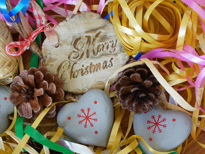 Celebration Close Up Communication Fir Cone Gift Heart Indoors  Lines And Shapes Love Merry Christmas Message Multicoloured Ribbons Multiple Colours Ribbons Text Textured  Wishes Millennial Pink Paint The Town Yellow