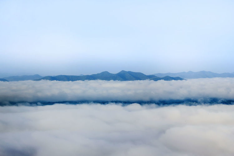 Scenic View Of Clouds And Mountains Against Sky