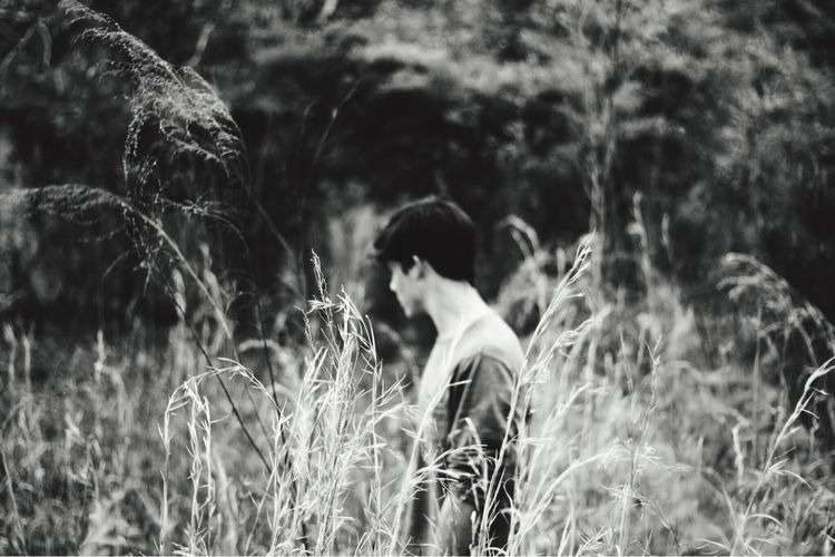 EyeEm Selects get lost & focus on what's different Real People Lifestyles Field Nature Leisure Activity Outdoors Growth Grass Focus On Foreground Plant Childhood Men Day Rear View Standing Boys Tree Beauty In Nature Adult