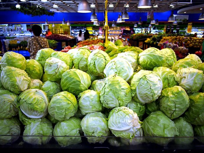Close-up of cabbages for sale at market stall