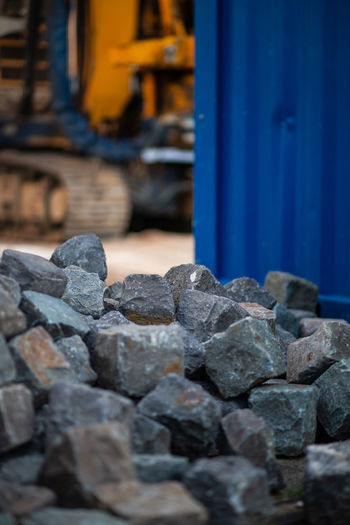 Construction Site Architecture Blue Built Structure Construction Industry Day Focus On Foreground Industry Metal Mode Of Transportation No People Outdoors Rail Transportation Railroad Track Rock Selective Focus Solid Stone - Object Track Transportation Wall - Building Feature