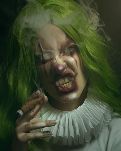Portrait of spooky woman smoking cigar