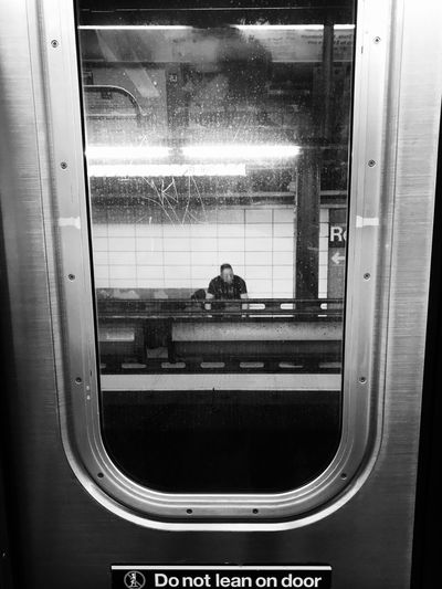 McKenzie Window Glass - Material Transparent Transportation Real People Indoors  Vehicle Interior Train - Vehicle Mode Of Transport Looking Through Window Journey Public Transportation Passenger Train Travel Men Passenger Rail Transportation Lifestyles Two People Day The Street Photographer - 2017 EyeEm Awards EyeEm Best Shots EyeEm Best Shots - Black + White New York City NYC