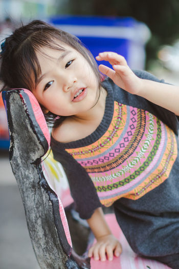 Casual Clothing Child Childhood Cute Day Emotion Females Focus On Foreground Front View Girls Innocence Leisure Activity Lifestyles One Person Outdoors Portrait Real People Smiling Warm Clothing Women