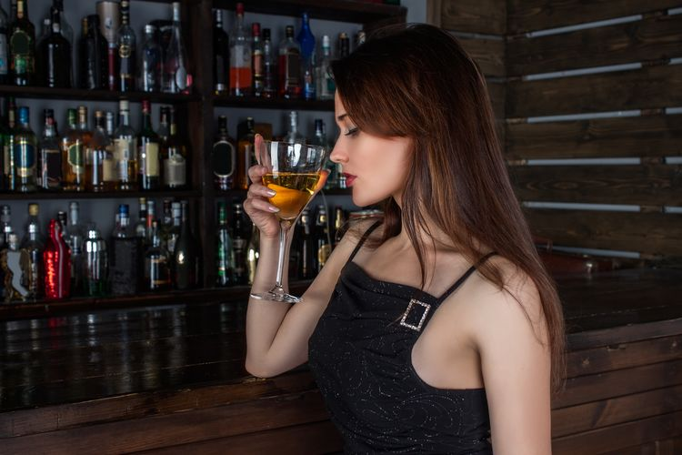 Woman drinking glass on table