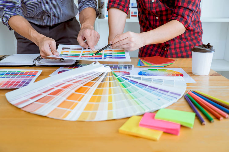 Creativity People Adult Holding Leisure Activity Men Colored Pencil Art And Craft Multi Colored Occupation Casual Clothing Paper Business Human Hand Design Professional Skill  Swatch Pantone Selective Color Idea Creative Designer  Graphic Design Inspiration Imagination