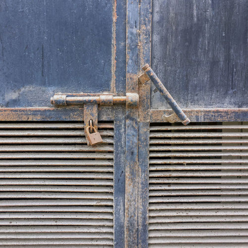 Aged Aged Metal Architecture Building Exterior Built Structure Close-up Closed Closed Door Corrugated Gray Iron Latch Lock Locked Door Metal Metallic No People Old Outdoors Pattern Protection Rusty Safety Security Used