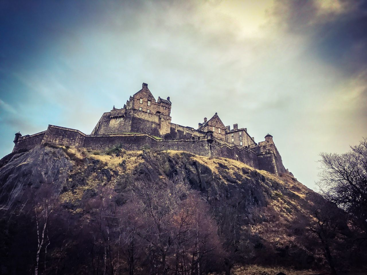 architecture, low angle view, sky, built structure, history, building exterior, day, no people, outdoors, cloud - sky, castle, nature, tree