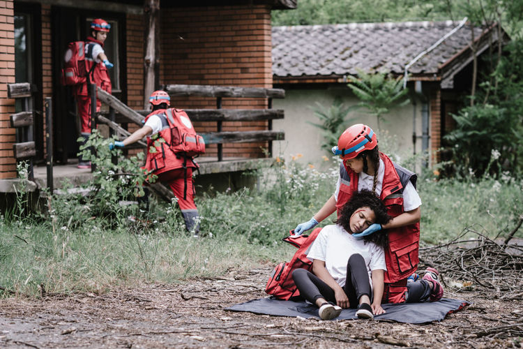 Rescue team helping injured female victim