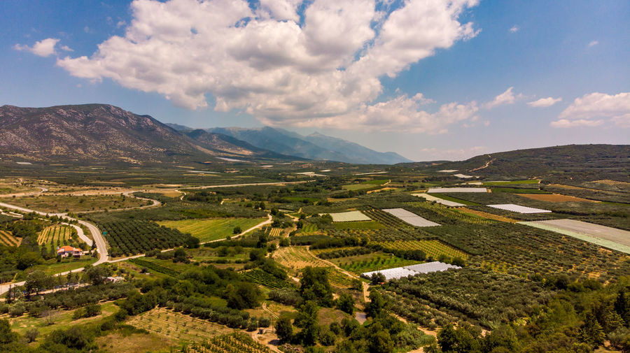 EyEmNewHere The Great Outdoors - 2018 EyeEm Awards Aerial View Agriculture Beauty In Nature Cloud - Sky Day Environment Farm Field Idyllic Land Landscape Mountain Mountain Range Nature Outdoors Patchwork Landscape Plant Plantation Rural Scene Scenics - Nature Sky Tranquil Scene Tranquility