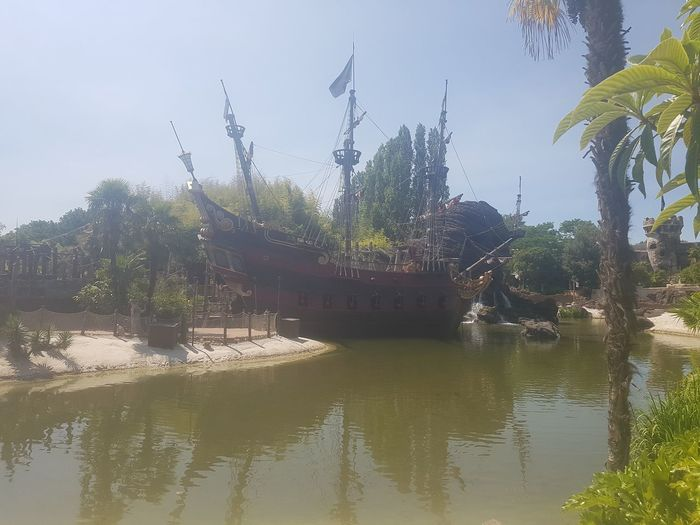 Here is a Photo shot of Captain Hooks Jolly Roger Ship which is located in Adventure Isle - Adventureland - Disneyland Park within Disneyland Resort Paris. Architecture Built Structure Day Disneyland Paris Disneyland Paris 💚🎆🗼 Disneyland Resort Paris Disneyland Resort Paris 2017 Disneyland Resort Paris 25th Anniversary Disneylandparis DLRP France France Trip Nature Nautical Vessel Nice Day Nice Views No People Outdoors Paris, France  River Sky Sunny Day Sunny Day 🌞 Tree Water Waterfront