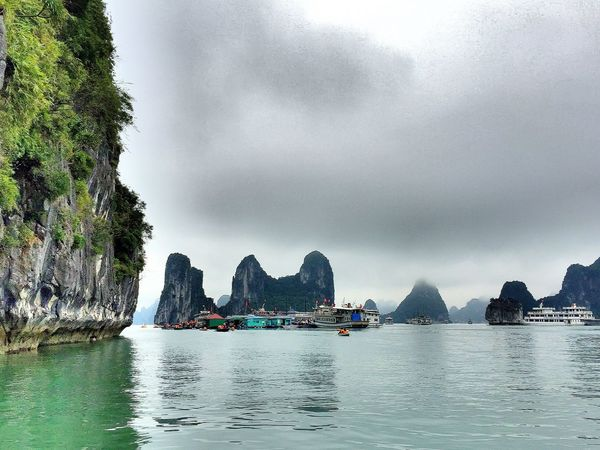 EyeEm Selects Halong Bay Vietnam HalongbayCruise Water Nature Rock - Object Scenics Tranquility Sky Sea Day No People Nautical Vessel Beauty In Nature Outdoors Misty Morning Rocks And Water Green Color Travel Destinations Travelphotography UNESCO World Heritage Site Vietnam