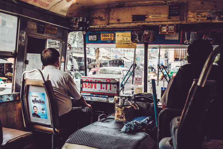 Bangkok Bus Ride People Of EyeEm Street Life Transportation Bus Bus Station Bus Stop Day Men Mode Of Transport One Person Out Of The Window Outdoors People Real People Rear View Seat Sitting Standing Streetphotography Transportation Travel Destinations