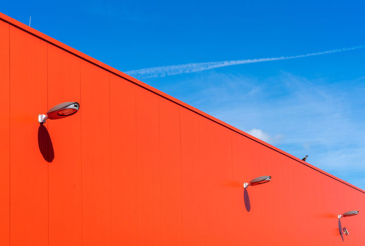 Low angle view of warehouse against blue sky