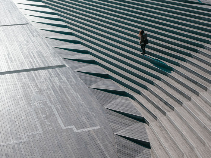 Architecture Pattern One Person Built Structure City High Angle View Sunlight Day Building Exterior Walking Shadow Full Length Staircase Striped Adult Outdoors Nature Abstract The Minimalist - 2019 EyeEm Awards My Best Photo