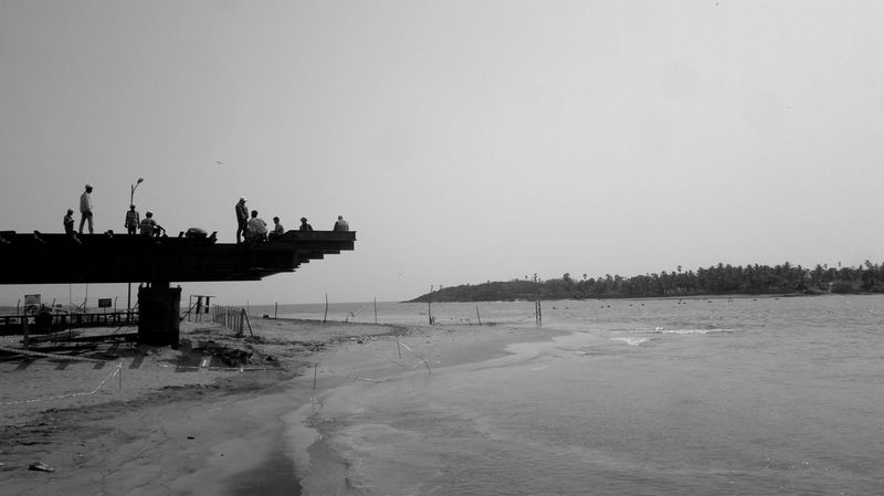 Bridging Bridging The Gap Silhouette Beach Beauty In Nature Blackandwhite Bridge - Man Made Structure Bridging Clear Sky Costruction Day Land Mode Of Transportation Nature Nautical Vessel Outdoors Sea Sea And Sky Seascape Seaside Silhouette_collection Sky Summer Summer ☀ Transportation Water A New Beginning