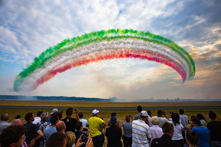 Air Show in Radom, 2017. Airplane Airshow Jet Fighter Plane Fighter Crowd Group Of People Large Group Of People Real People Sky Cloud - Sky Motion Flying Nature Men Smoke - Physical Structure Multi Colored on the move Air Vehicle Rear View Transportation Women Outdoors Watching Plane Vapor Trail Spectator Italian