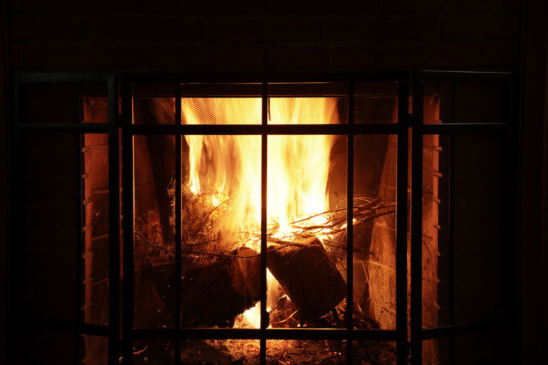 Close-up Cozytime Fire Fireplace Warmth Indoors  No People Security Bar Warmth On A Wnter Day Window Wood Burning