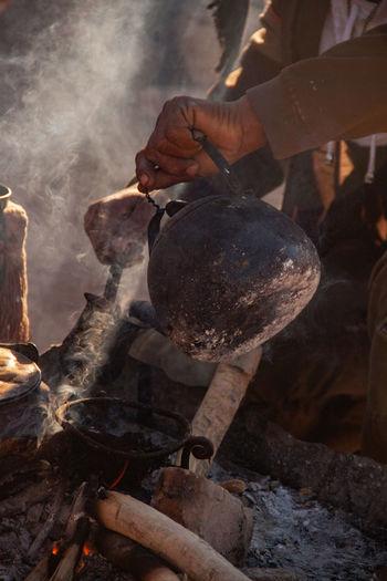 Man working on bonfire