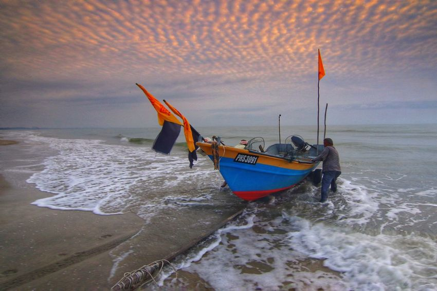 Fisherman and the boat Sunrise Boat Wave Sea Seascape Beach Dramatic Sky Flag Morning Blue Fisherman Fishing Boat Sunrise Morning Sky Water Sea Beach Fisherman Wave Sand Sky Horizon Over Water Seascape Longtail Boat