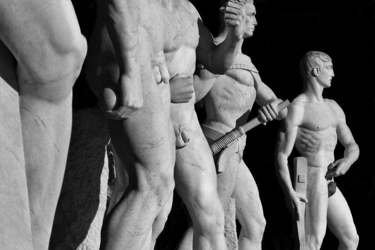 Close-up of male statue at stadio dei marmi. rome