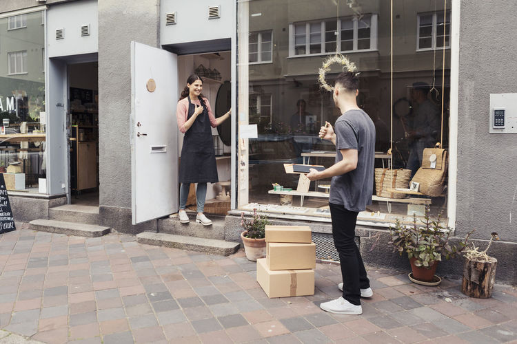Young couple standing outside building